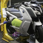 A mechanic makes check on BMW C evolution electric maxi-scooter at BMW motorcycle plant in Berlin